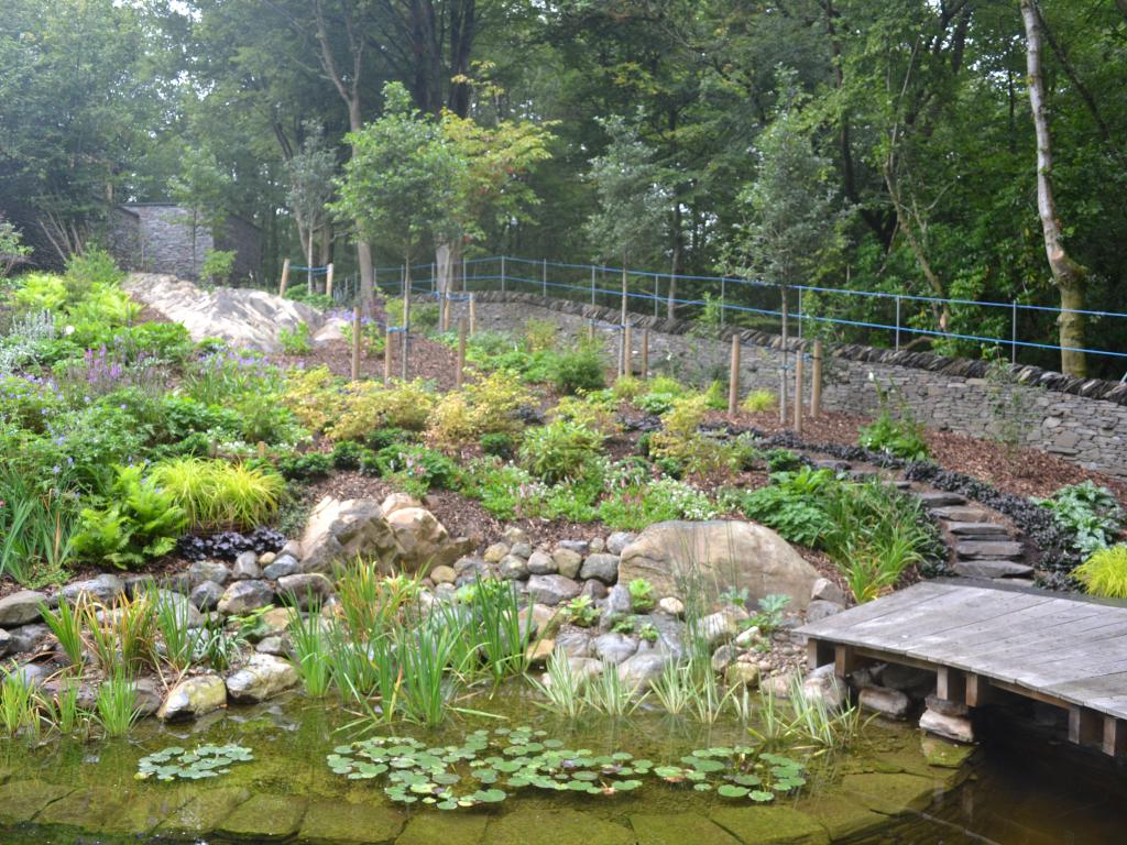 Natural ponds article 1e pathways and edging for informal for Garden pond edging stones