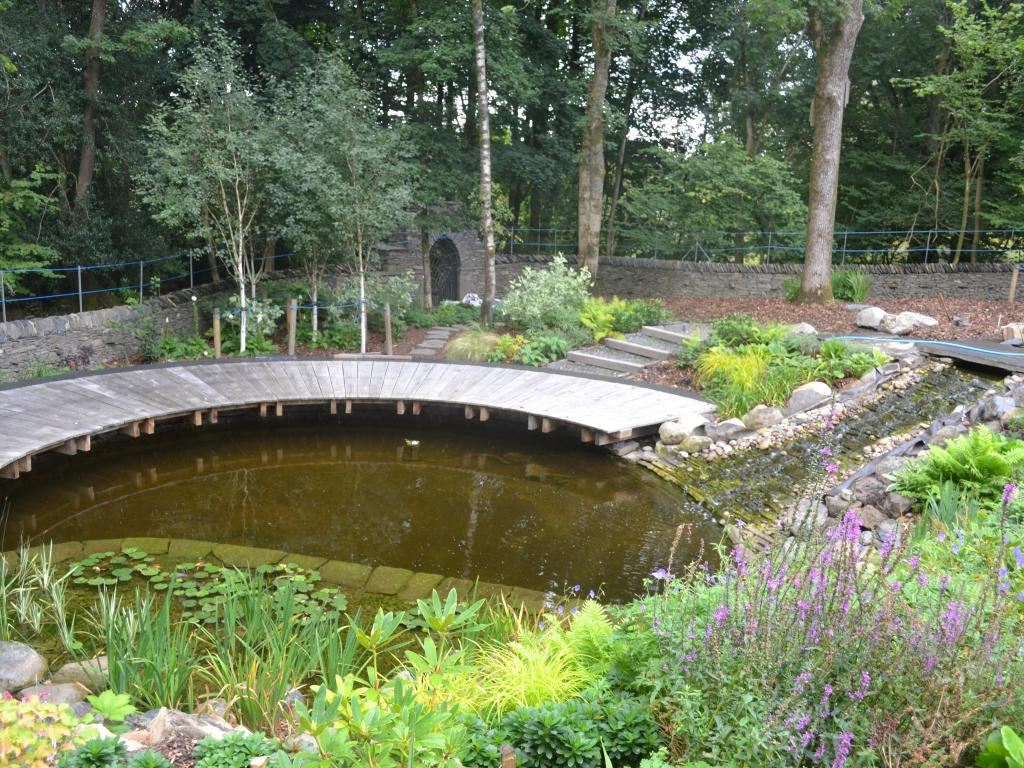 Natural ponds article 1e pathways and edging for informal for Garden pond edging